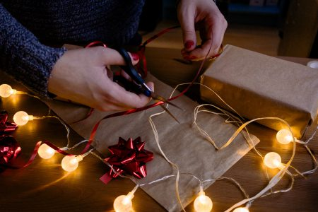 Female decorating a gift - free stock photo