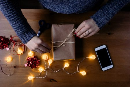 Female decorating a gift 2 - free stock photo