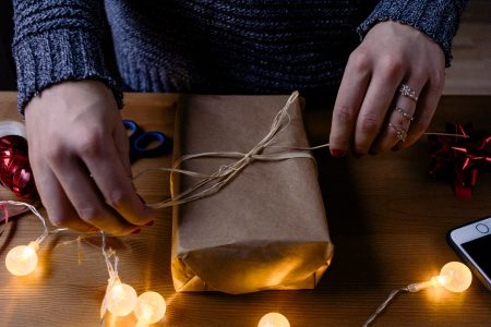 Female decorating a gift 3 - free stock photo