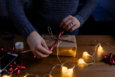 A female decorating a gift 4 - free stock photo
