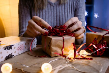 A female decorating a gift 5 - free stock photo