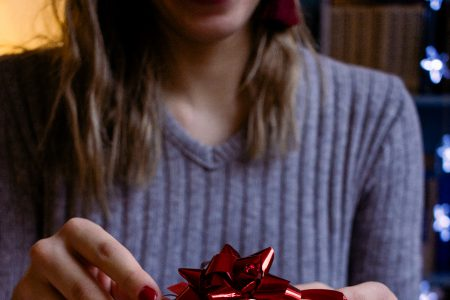 A female decorating a gift 6 - free stock photo