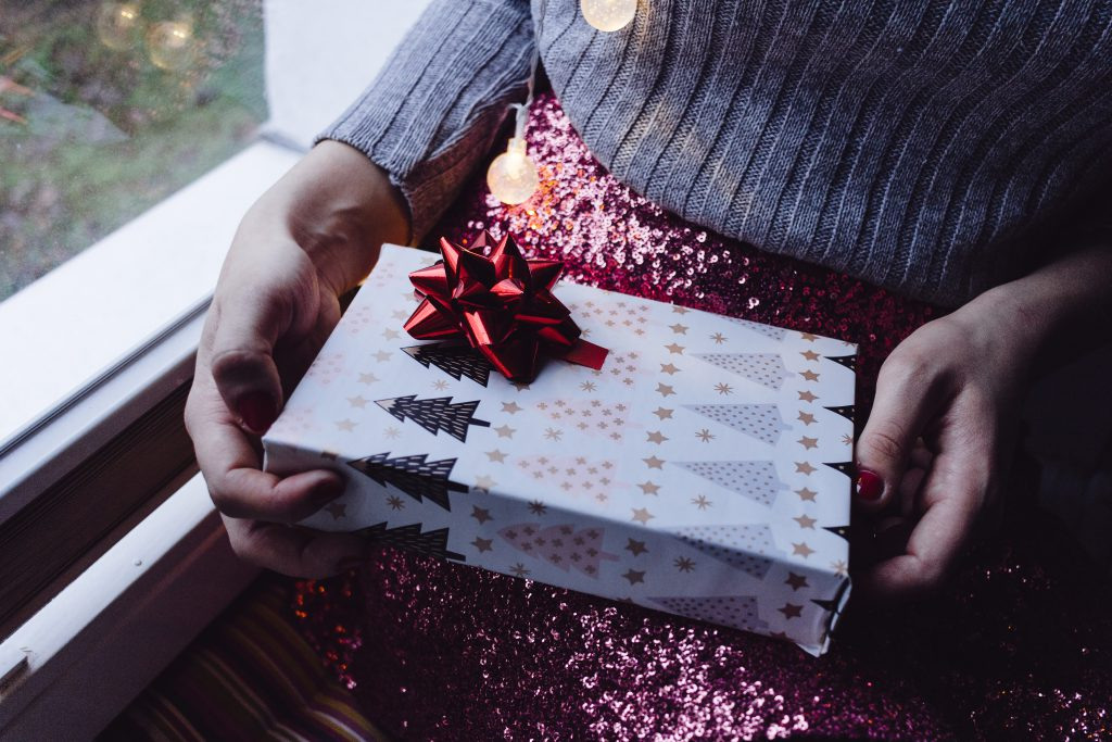 A female holding a christmas gift - free stock photo