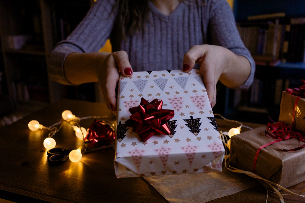 A female holding a christmas gift 2 - free stock photo