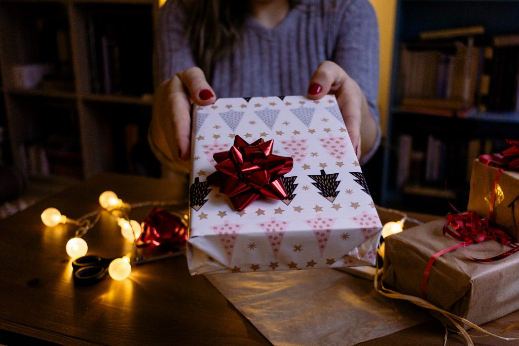 A female holding a christmas gift 3 - free stock photo