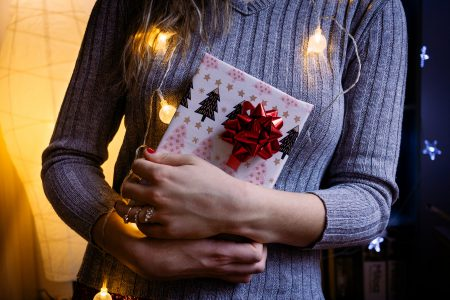 A female holding a christmas gift 4 - free stock photo