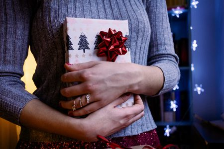 A female holding a christmas gift 5 - free stock photo