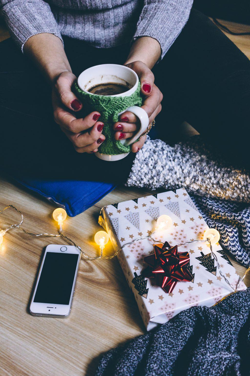 A female holding a mug in a festive setting 2 - free stock photo