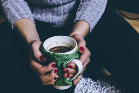 A female holding a mug in a festive setting 2 - free stock photo