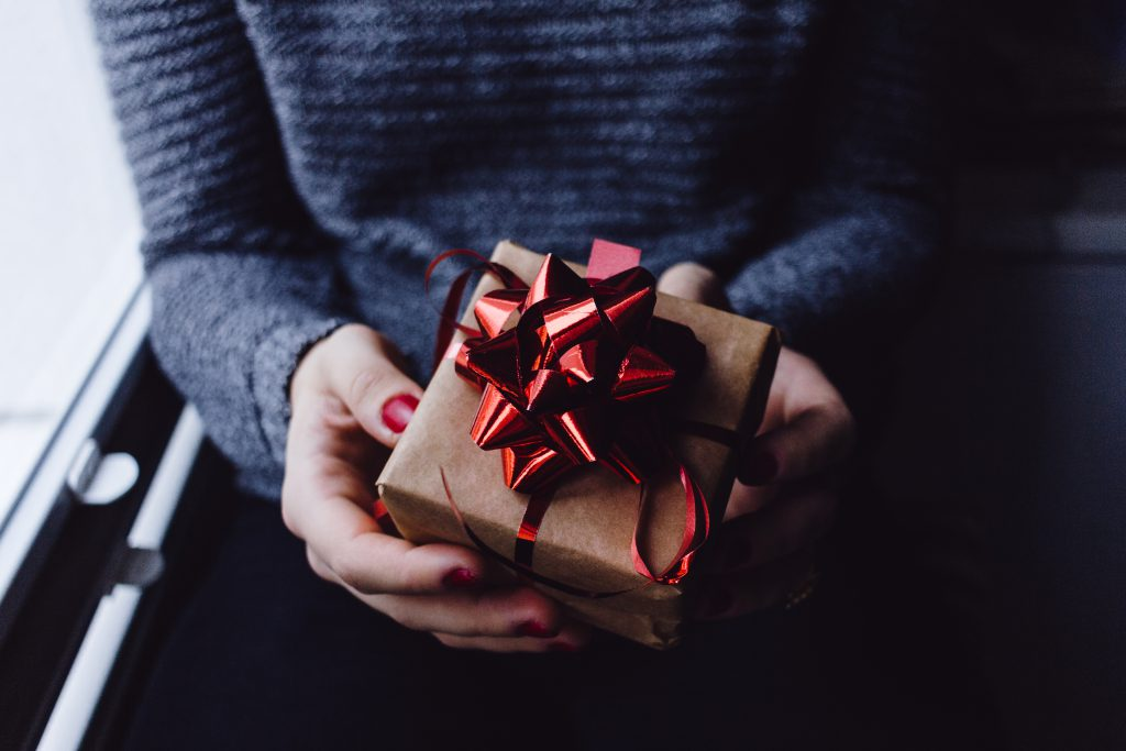 A female holding a wrapped gift - free stock photo