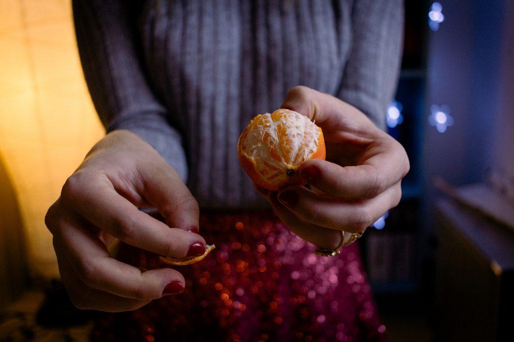 A female peeling a mandarin - free stock photo