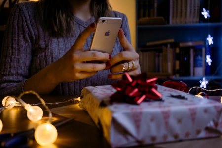 A female taking picture of a christmas gift 4 - free stock photo