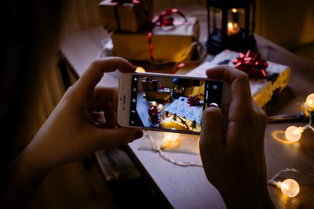 A female taking picture of a christmas gift 5 - free stock photo