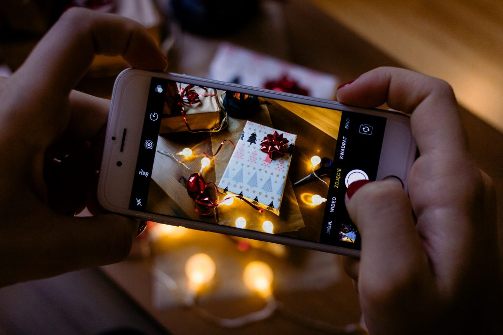 A female taking picture of a christmas gift 6 - free stock photo