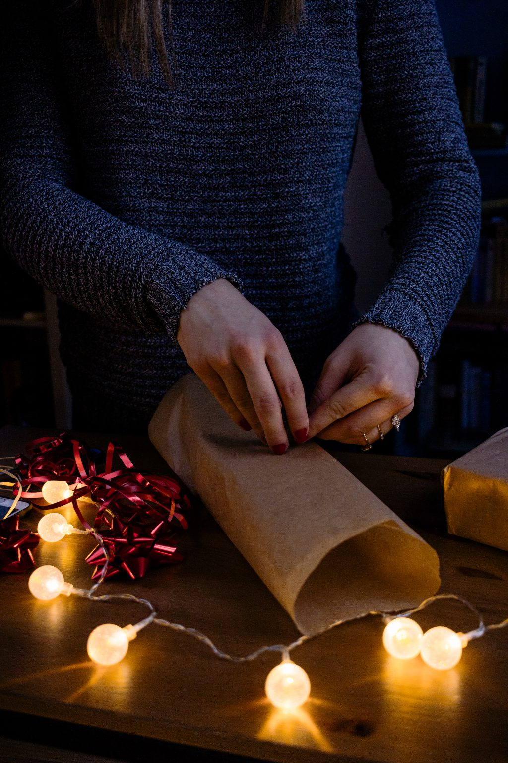 A female wrapping a gift - free stock photo