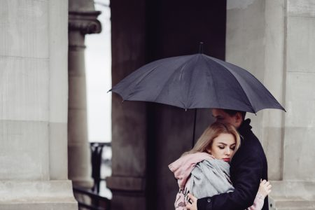 Couple hugging under an umbrella - free stock photo
