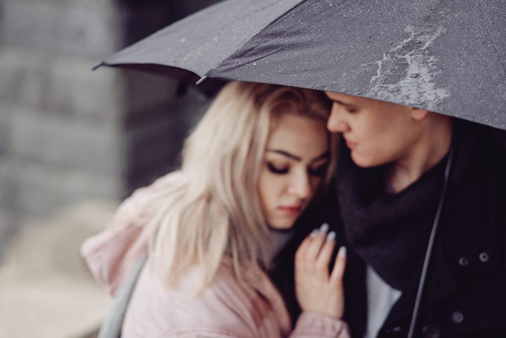 Couple hugging under an umbrella 2 - free stock photo