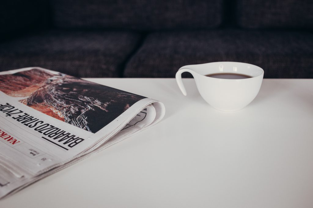 Cup of coffee and a newspaper on the table 2 - free stock photo