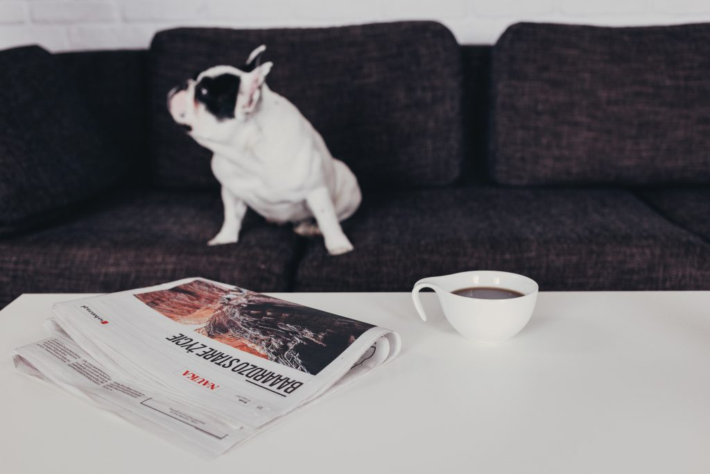 Cup of coffee and a newspaper on the table 3 - free stock photo