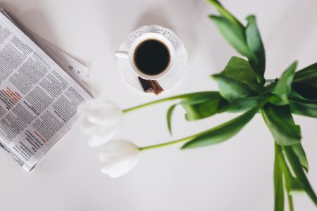 Cup of coffee and a newspaper on the table 4 - free stock photo