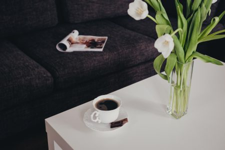 Cup of coffee and tulips on the table - free stock photo
