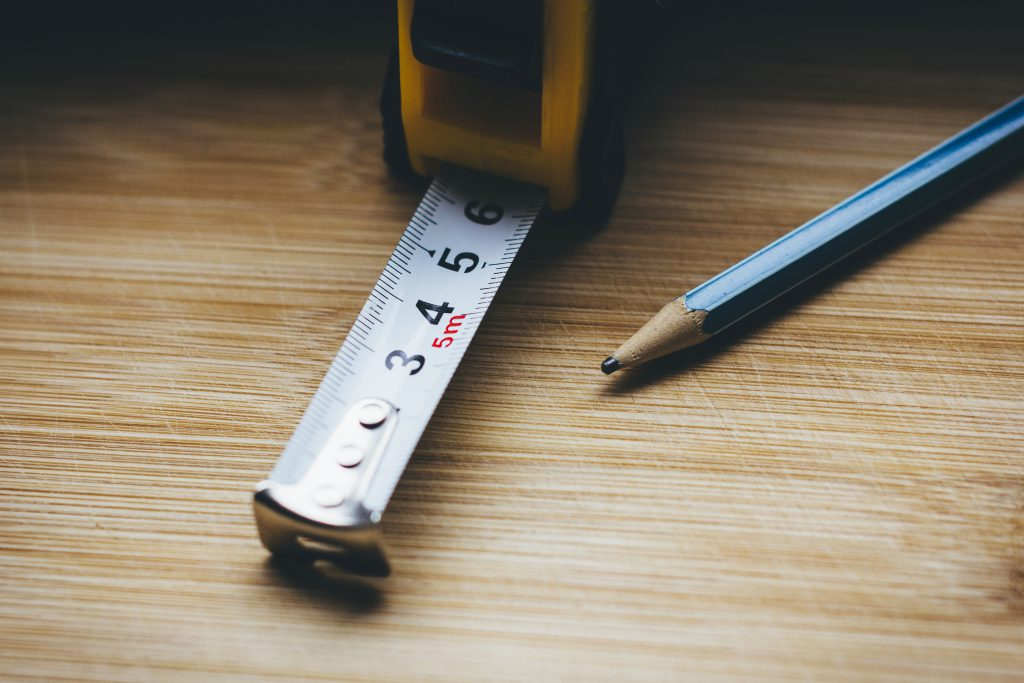 Metal tape measure tool and a pencil - free stock photo