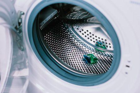 Laundry detergent pod inside a washing machine - free stock photo