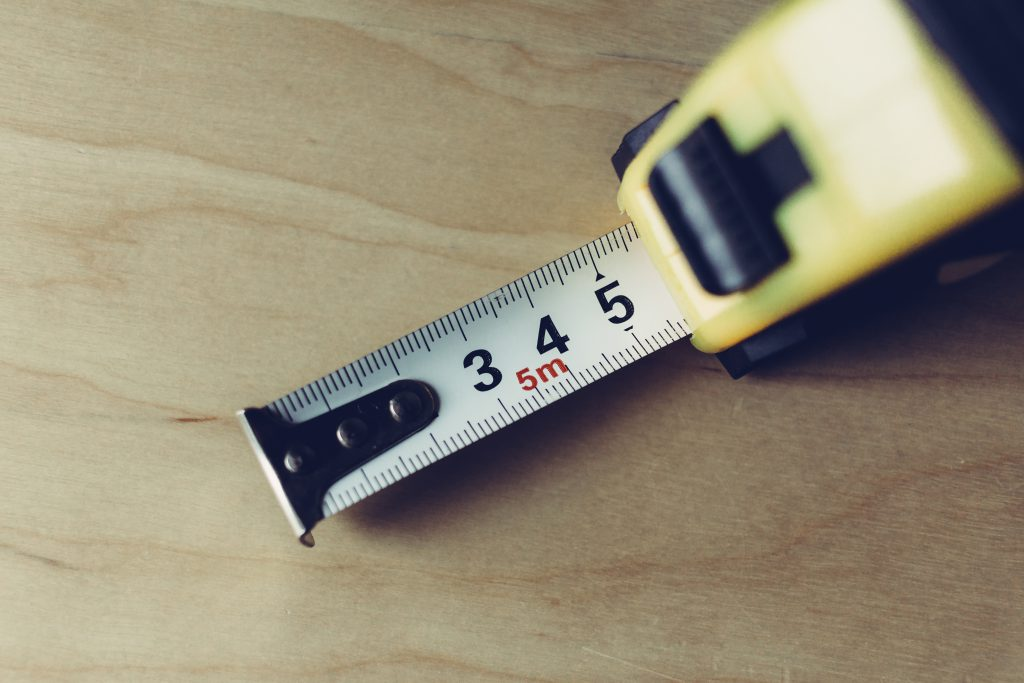 Metal tape measure tool closeup - free stock photo