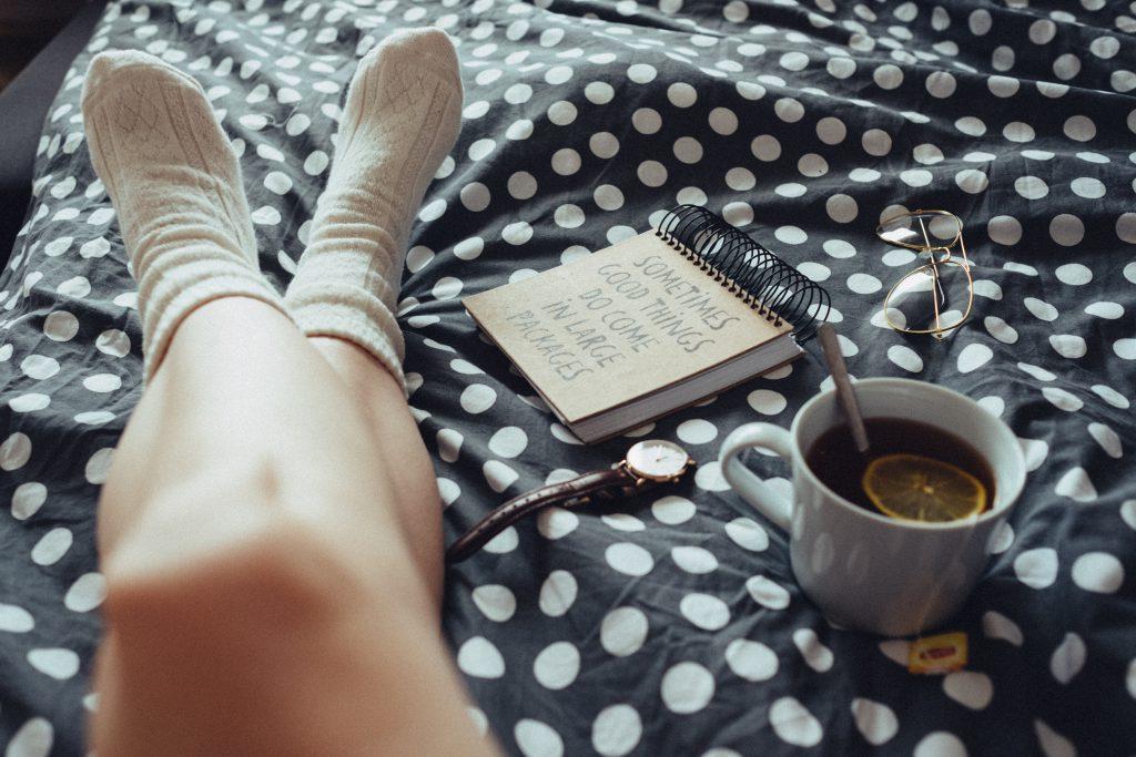 Chilling in bed in woollen socks - free stock photo