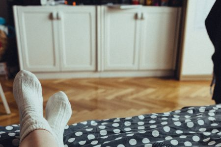 Chilling in bed in woollen socks 3 - free stock photo