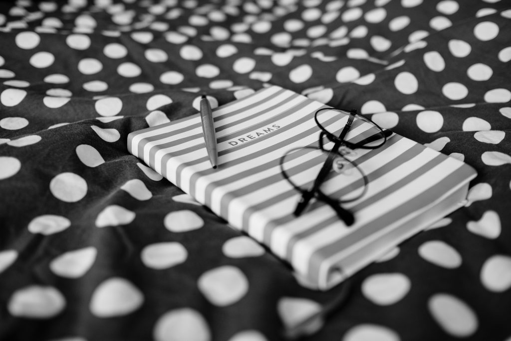 Dreams notebook and glasses - free stock photo