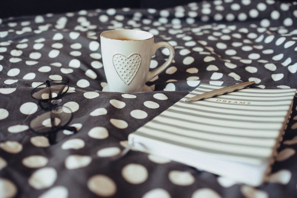 Dreams notebook, glasses and coffeemug - free stock photo