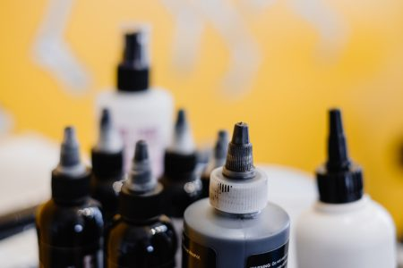 Tattoo ink bottles closeup - free stock photo