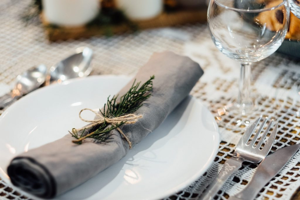 Linen napkin decorated with a conifer twig 2 - free stock photo