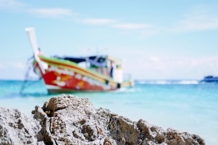 A blurry boat at the beach in Thailand - free stock photo