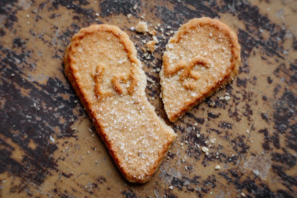 Broken heart-shaped cookie - free stock photo