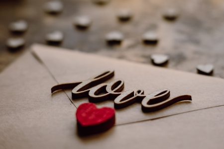 Wooden word love on a beige envelope - free stock photo