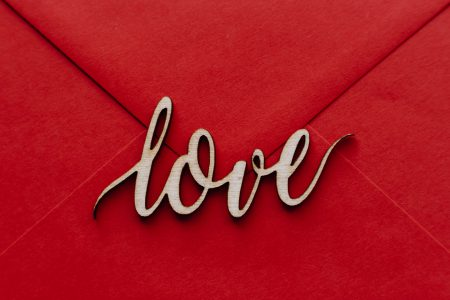Wooden word love on a red envelope - free stock photo