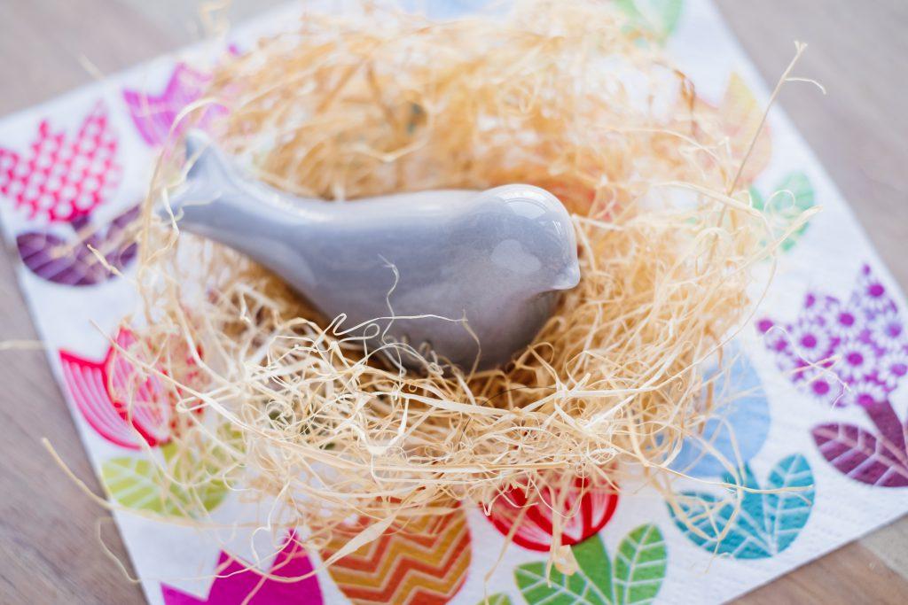 Ceramic bird in a nest - free stock photo