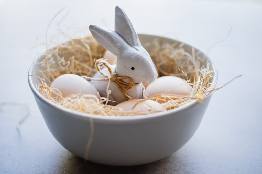 Ceramic Easter Bunny and plain eggs in a bowl - free stock photo