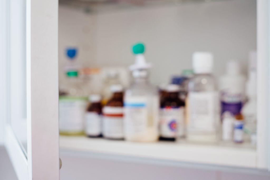 Medicine bottles on a shelf - free stock photo