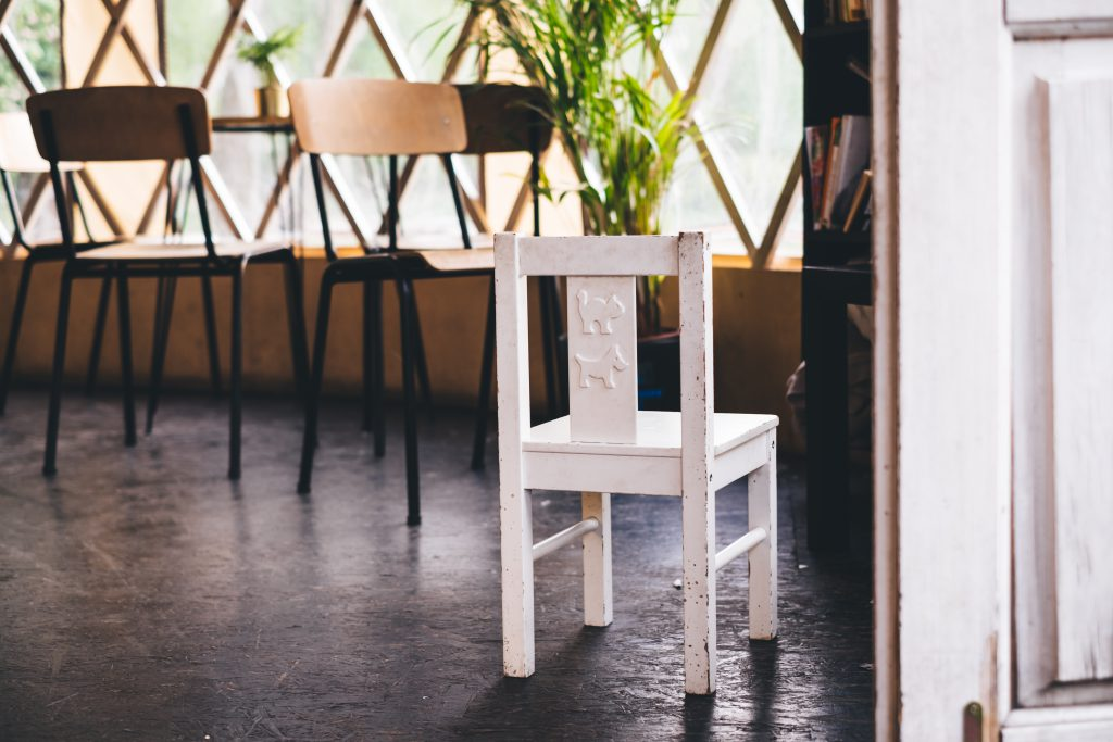 Damaged kid's chair in a retro interior - free stock photo