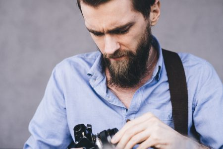 A man holding an analog camera - free stock photo