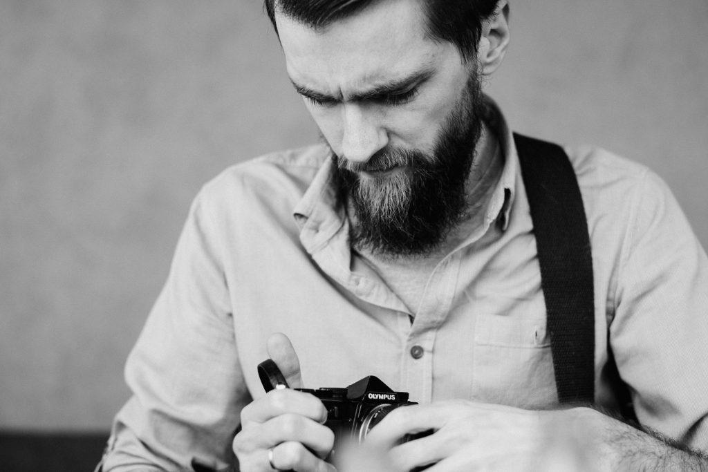 A man holding an analog camera 2 - free stock photo