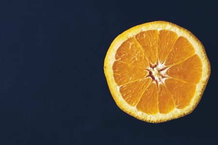 An orange cut in half - free stock photo