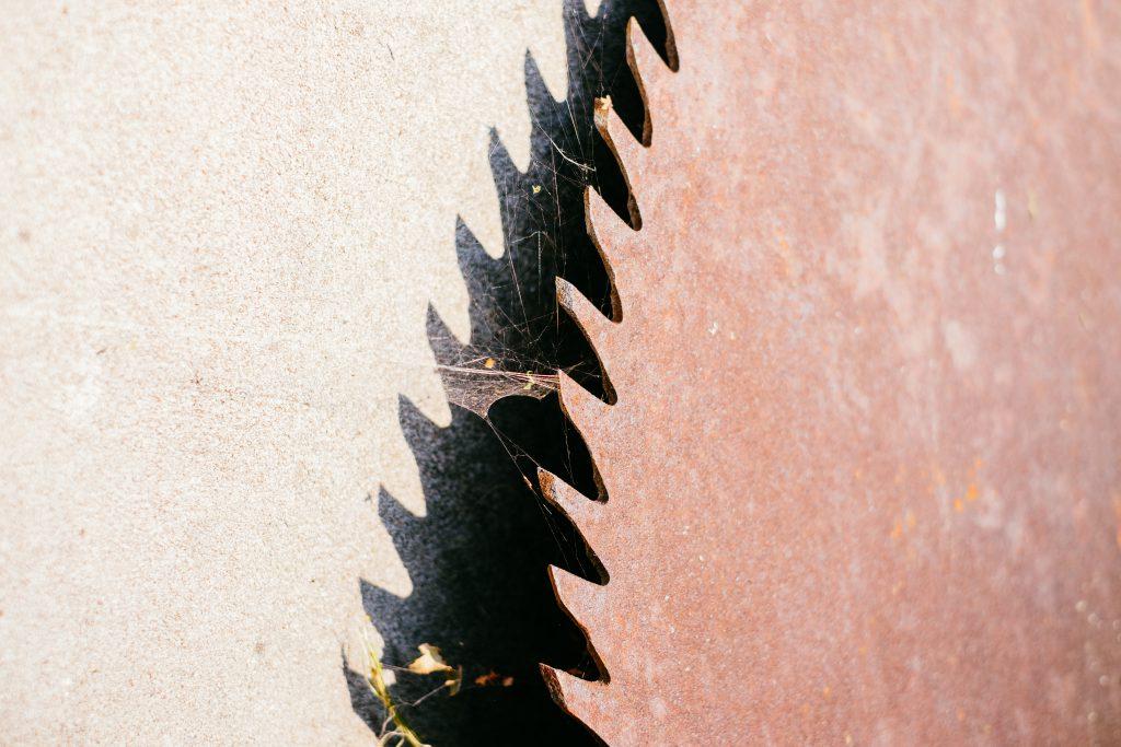 Old rusty saw blade closeup - free stock photo