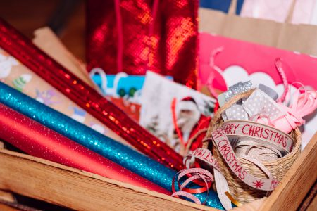 Christmas bags, wrapping paper and ribbons - free stock photo