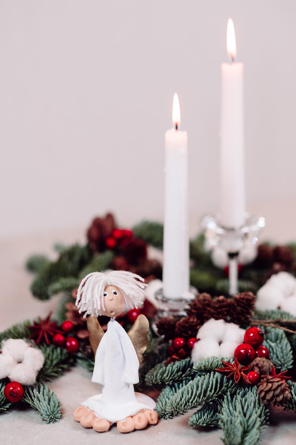 Christmas spruce decoration with candles and an angel - free stock photo