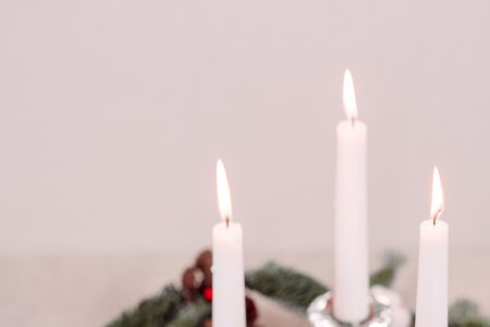 Christmas spruce decoration with candles and snowmen - free stock photo