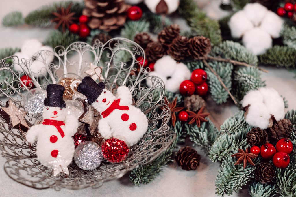 Christmas spruce decoration with snowmen - free stock photo